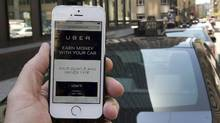 Quebec's taxi industry is stepping up its fight against ride-hailing giant Uber Technologies Inc., unveiling plans to file a court injunction this week seeking to shut down the service in the province. (Ryan Remiorz/THE CANADIAN PRESS)