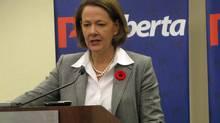 Alberta Premier Alison Redford speaks to reporters at the Alberta Progressive Conservative Party annual convention in Calgary on Saturday, Nov. 10, 2012. (Bill Graveland/THE CANADIAN PRESS)