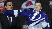 Jonathan Drouin, right, did himself no favours with his actions by cancelling a chance to showcase himself in front of dozens of scouts congregating in Toronto to watch him play against the Marlies. (Bill Kostroun/AP Photo)