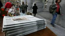 Copies of the San Francisco Chronicle are on display at a newspaper stand. (Justin Sullivan/Getty Images)