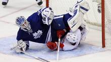 Toronto Maple Leafs goalie Jonas Gustavsson (50) is upended by Detroit Red Wings center Jiri Hudler (26) at the Air Canada Centre. The Maple Leafs beat the Red Wings 4-3. Tom Szczerbowski-US PRESSWIRE (Tom Szczerbowski/US PRESSWIRE)