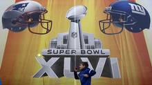 The NFL's hard line approach forces a showdown between Bell and the Canadian Radio-television and Telecommunications Commission over how content is shared on mobile devices, following a regulatory decision last year that required broadcasters to give up exclusive content deals. (Jim Young/Reuters/Jim Young/Reuters)