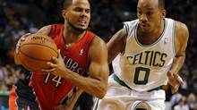Oct 7, 2013; Boston, MA, USA; Toronto Raptors point guard D.J. Augustin (14) drives the ball against Boston Celtics guard Avery Bradley (0) in the second half at TD Garden. (David Butler II/David Butler II-USA TODAY Sports)
