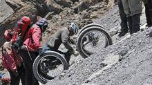 Chris Waddell uses arm power to scramble up Mount Kilimanjaro, becoming the first paraplegic athlete to reach the summit under his own steam.