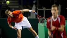 Canada's Daniel Nestor, left, of Toronto, Ont., serves while playing with Vasek Pospisil against Spain's Marcel Granollers and Marc Lopez during a Davis Cup tennis world group first-round tie doubles match in Vancouver, B.C., on Saturday February 2, 2013. (DARRYL DYCK/THE CANADIAN PRESS)
