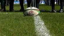 A rugby ball is placed on the ground (NACHO DOCE/REUTERS)