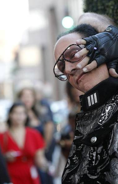 Andrew Dice Clay does us all a favour and tries to rip his own head off at the premiere of Blue Jasmine in Beverly Hills, Calif., last week. (Mario Anzuoni/Reuters)