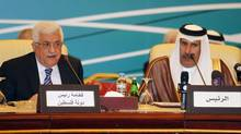 Palestinian President Mahmoud Abbas (L) speaks next to Qatari Prime Minister and Foreign Minister Hamad bin Jassim al-Thani during the Arab Peace Initiative Committee Meeting in Doha December 9, 2012. (MOHAMMED DABBOUS/REUTERS)