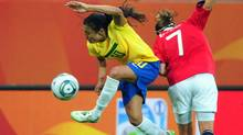 Brazil's striker Marta (L) vies for the ball with Norway's defender Trine Ronning (R) during the Group D football match of the FIFA women's football World Cup Brazil vs Norway in Wolfsburg, central Germany, on July 3, 2011. (JOHANNES EISELE)