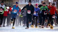 Racers compete in the 10km Switchback Challenge, a high endurance snowshoe race along the Bruce Trail at Craigleith Ski Club in Craigleith, Ont., Feb. 20, 2011. (Tim Fraser For The Globe and Mail)