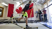 Canadian cross-country skier Ivan Babikov, uses a $200,000 treadmill unveiled during a news conference in Canmore, Alta., Wednesday, Sept. 12, 2012. The Canadian Nordic team is hoping the new equipment will help achieve more medals at the Olympics and other international competitions. (Jeff McIntosh/THE CANADIAN PRESS)