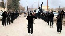 This undated file image posted on a militant website on Jan. 14, 2014, which has been verified and is consistent with other AP reporting, shows fighters from the Islamic State group marching in Raqqa, Syria. (Associated Press)