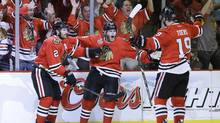 Chicago Blackhawks' Patrick Kane (88), center, celebrates with center Jonathan Toews (19) and defenseman Duncan Keith (2) after scoring a goal against the Boston Bruins in the second period during Game 5 of the NHL hockey Stanley Cup Finals, Saturday, June 22, 2013, in Chicago. (Nam Y. Huh/AP)