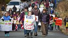 Residents of the British Columbia community of Bella Bella protest against the proposed Northern Gateway pipeline. (Anthony Bonello for The Globe and Mail)