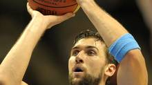 Andrea Bargnani (R) of Italy vies during a match against Latvia during a 2011 European championship qualifying round, group B, basketball game in Siauliai on September 2, 2011. Getty Images/ JANEK SKARZYNSKI (JANEK SKARZYNSKI/Getty Images)