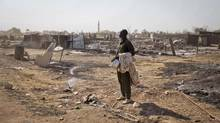 Up to 10,000 people are dead and 825,000 have fled their homes in just six weeks as government forces clash with rebels in South Sudan. A ceasefire was called last Friday, but reports indicate fighting is still ongoing. (Mackenzie Knowles-Coursin/AP)
