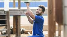 Blue Jays second baseman Devon Travis works out in advance of the official opening of spring training in Dunedin, Fla., on Monday. (Nathan Denette/THE CANADIAN PRESS)