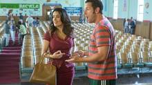 Salma Hayek stars as Roxanne Chase-Feder and Adam Sandler stars as Lenny Feder in Grown Ups 2.