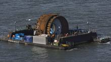 Technicians prepare to deploy the first commercial in-stream tidal turbine in the Bay of Fundy near Parrsboro, N.S. on Thursday, Nov. 12, 2009. Nova Scotia and British Columbia have signed a memorandum of understanding that will allow them to co-operate in the development of tidal power. (ANDREW VAUGHAN/The Canadian Press)
