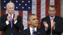 U.S. House Speaker John Boehner (right) and Vice President Joe Biden (left) stand to applaud as President Barack Obama delivers his State of the Union speech on Capitol Hill in Washington, February 12, 2013. (Charles Dharapak/Reuters)