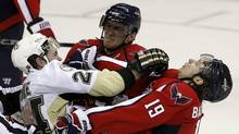 Alex Ovechkin of the Washington Capitals and team mate Nicklas Backstrom retaliate after a trip on Ovechkin by Matt Cooke of the Pittsburgh Penguins during their NHL hockey game in Washington Feb. 6, 2011. (KEVIN LAMARQUE/KEVIN LAMARQUE/REUTERS)