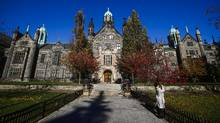 People walk on campus at Trinity College on University of Toronto campus in Toronto on Nov. 12, 2016. (Mark Blinch For The Globe and Mail)