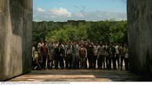 In The Maze Runner, young men, including Thomas (Dylan OBrien, centre, pointing) trapped at an undisclosed locale, investigate the mysteries of a massive maze. (Twentieth Century Fox)