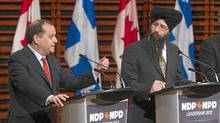 NDP federal leadership candidate Brian Topp, left, responds to a question during an NDP leadership debate in Quebec City as Martin Singh looks on, Sunday Feb.12, 2012. (CLEMENT ALLARD/THE CANADIAN PRESS/CLEMENT ALLARD/THE CANADIAN PRESS)