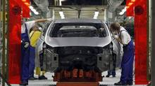 Workers assemble cars in Kia's factory in Zilina, Slovakia, Oct. 3, 2012. African leaders hope to emulate South Korea's economic growth.