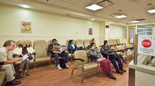 People wait to see a doctor in the Emergency/Trauma Unit waiting area at Sunnybrook Hospital on Dec. 5, 2010. (JENNIFER ROBERTS/Jennifer Roberts for The Globe and Mail)