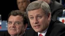 Canadian Prime Minister Stephen Harper speaks to the B20 Business Summit as Minister of Finance Jim Flaherty looks on at the G20 Summit in Toronto, Saturday June 26. (Adrian Wyld/Adrian Wyld/The Canadian Press)