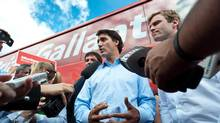 Federal Liberal Leader Justin Trudeau, centre, and New Brunswick Liberal Leader Brian Gallant, right, speak with the media in Moncton, N.B. (Marc Grandmaison/THE CANADIAN PRESS)
