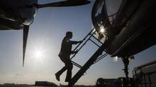 Man boarding a plane, in this case used for illustrative purposes. (John Lehmann/The Globe and Mail)