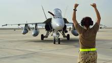 A Canadian Armed Forces CF-18 Fighter jet from 409 Squadron taxis after landing in Kuwait on Tuesday, October 28, 2014. (DND/THE CANADIAN PRESS)