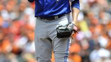 Toronto Blue Jays starting pitcher Josh Johnson wipes his face after giving up four runs to the Baltimore Orioles in the first inning of a baseball game on Sunday, July 14, 2013, in Baltimore. (GAIL BURTON/AP)