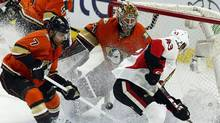 Ottawa Senators' Ryan Dzingel (43)Anaheim Ducks' Andrew Cogliano (7) and goaltender Frederik Andersenn (31) try to gain control of a loose puck during second period NHL hockey action in Ottawa on Saturday March 26, 2016. (FRED CHARTRAND/THE CANADIAN PRESS)