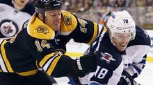 Boston Bruins' Joe Corvo (14) gets an interference call while defending Winnipeg Jets' Bryan Little (18) in the first period of an NHL hockey game in Boston, Saturday, Nov. 26, 2011. (AP Photo/Michael Dwyer) (Michael Dwyer/AP)