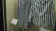 A display of prisoners' uniforms is shown at the Holocaust Museum in Montreal, Monday, Jan. 24, 2005. Canadian Jewish leaders are asking online retailers to be more vigilant, after an investigation by the Mail on Sunday newspaper in Britain found a Vancouver man and several other eBay retailers auctioning clothing and items that belonged to victims of Nazi concentration camps. (RYAN REMIORZ/THE CANADIAN PRESS)