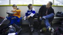 Alan Davidson's sons Callum, left, and Matthew, 12, (blue sweater) are photographed at McCormick Arena in Toronto, Ontario Friday March 4/2016. (Kevin Van Paassen for The Globe and Mail)