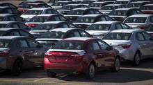 New cars are seen at the Toyota plant in Cambridge, March 31, 2014. Toyota Motor Corp. plans to shift production of Corolla compact cars from Cambridge, Ont., to a new factory in Mexico, ending an era that began when the company opened its first Canadian assembly plant in 1988. (MARK BLINCH/REUTERS)