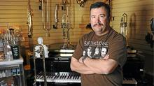 Michael Durocher, shown at Campbell's Music Store on May 9, 2012, was laid off from Keyano College in Fort McMurray where he taught musical instrument repair. (Jacquie McFarlane for The Globe and Mail/Jacquie McFarlane for The Globe and Mail)