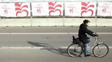A cyclist pedals past the Bella center in Copenhagen, Oct. 1, 2009. (Odd Andersen/Odd Andersen/The Associated Press)
