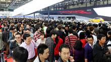 Visitors flock to the Shanghai Auto Show. (PHILIPPE LOPEZ/AFP/Getty Images)