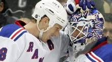 New York Rangers defender Marc Staal (18) congratulates goalie Henrik Lundqvist (30) after defeating the Pittsburgh Penguins during the third period at the CONSOL Energy Center. The Rangers won 3-1. Charles LeClaire-USPRESSWIRE (Charles LeClaire/USPRESSWIRE)