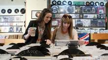 Olivia Gregoris, left, and Cassandra Johnston shop at Kops Records in Toronto on Wednesday, July 9, 2014. (MATTHEW SHERWOOD FOR THE GLOBE AND MAIL)