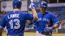 Toronto Blue Jays' J.P. Arencibia (R) celebrates his two-run home run with teammate Brett Lawrie during the ninth inning of their major league baseball game against the Tampa Bay Rays in St. Petersburg, Florida May 6, 2013. (SCOTT AUDETTE/REUTERS)
