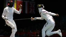 Canada's Sherraine Schalm faces South Korea's A Lam Shin during a women's individual epee fencing round of 32 match at the 2012 Summer Olympics, Monday, July 30, 2012, in London. (Associated Press)