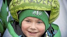 Liam Wolsey, 10, from Lethbridge, Alta. attends his first Grey Cup complete with Watermelon head Commonwealth Stadium in Edmonton on Sunday, November 28, 2010. (Chris Bolin for The Globe and Mail/Chris Bolin for The Globe and Mail)