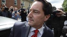 Montreal Mayor Michael Applebaum gets into a car outside police headquarters in Montreal, Monday, June 17, 2013. Applebaum was arrested earlier as part of a bribery case. (Ryan Remiorz/THE CANADIAN PRESS)