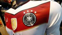 A memorabilia jersey of German national soccer team showing four stars, symbolizing the number of reached World Cup championships, is seen at an Adidas retailer in Frankfurt July 14, 2014. (RALPH ORLOWSKI/REUTERS)